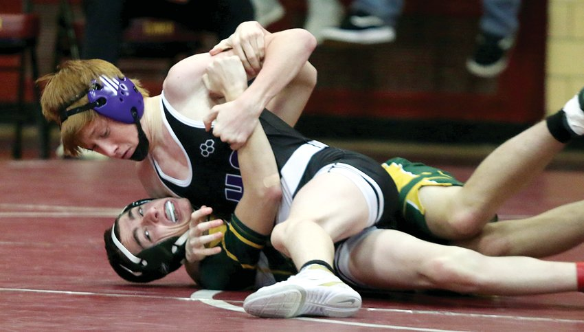 Litchfield 120-pounder Brady Davidson works to get the pin against Jake Fiudo of Metro-East Lutheran in the consolation semifinals of the East Alton-Wood River Regional on Saturday, Feb. 8. Davison would be successful in his efforts, then pinned Justis Theis of Roxana in the third place match to earn his first trip to sectionals.