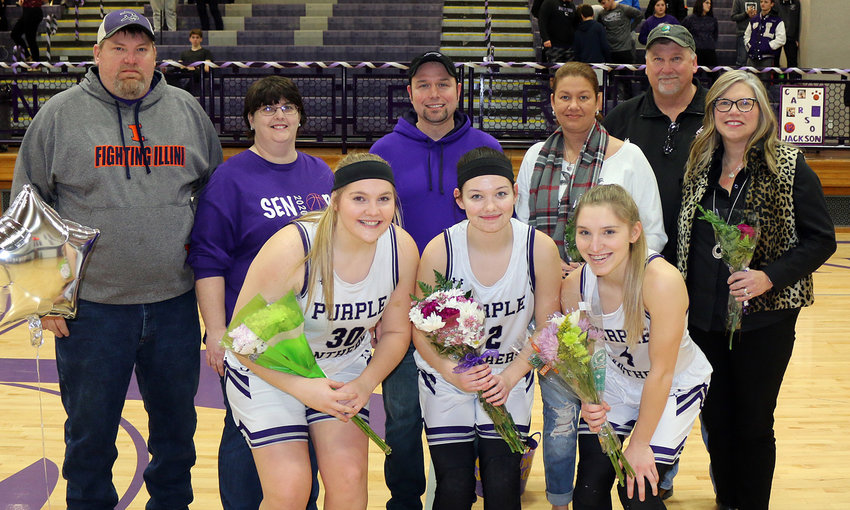The three senior members of the Litchfield High School girls basketball team were recognized on senior night prior to the Panthers' 45-24 win over Roxana. From the left are Carly Boden, with parents, Mike and Angie Boden; Carson Jackson, with parents, Jeremy Jackson and Amber Zumwalt; and Emily Senjan, with parents, John and Pam Senjan.
