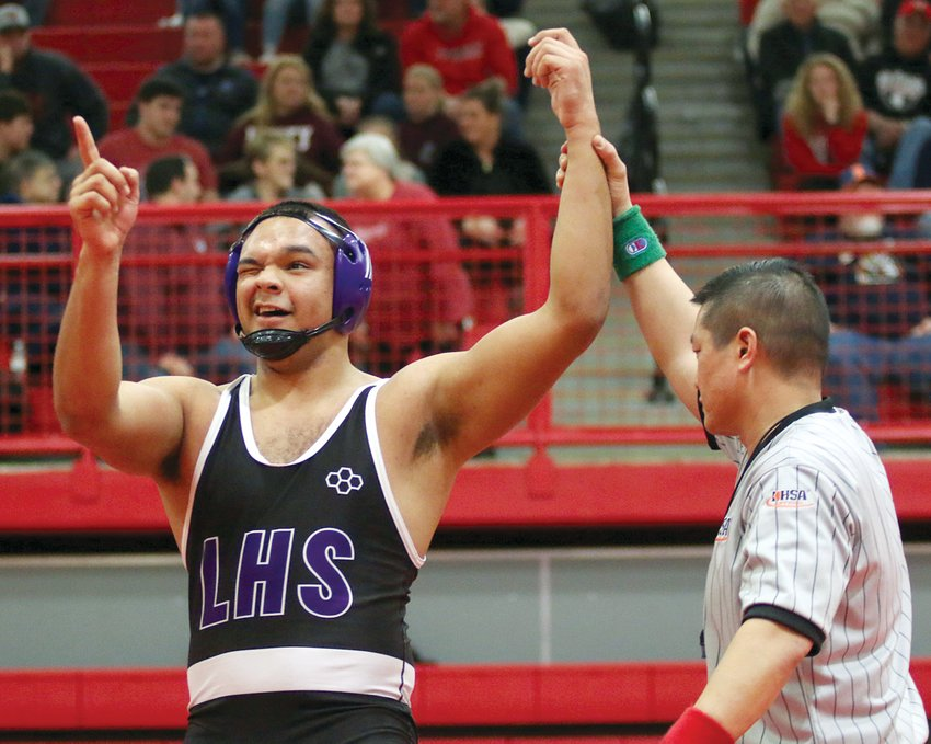 With a wink and a point to his family in the stands at Vandalia High School, Litchfield's Jefferson Thomas celebrates the victory over Caleb Bass of Red Bud that earned him a spot in this weekend's IHSA Class 1A State Wrestling Tournament. Thomas, a senior 220-pounder, went on to finish third at the sectional in Vandalia and will face Joel Baer of Eureka in his first match at state on Feb. 20.
