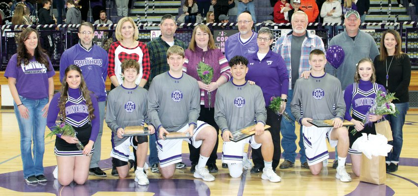 It was senior night for the Litchfield High School boys basketball and cheerleading teams on Friday, Feb. 14. Seniors honored, from the left, were Abbe Kuehn, Brady Bishop, Anthony Boston, John Corso, Austin Niehaus and Grace Flannery. In the back are Chris Heaps, Kyle and Nikki Bishop, Chris and Deanna Boston, Rob and Patrice Corso, Randy Hancock, Scott Flanery and Tonya Flannery. Photo courtesy of Denise Simpson/DT Sports Photography