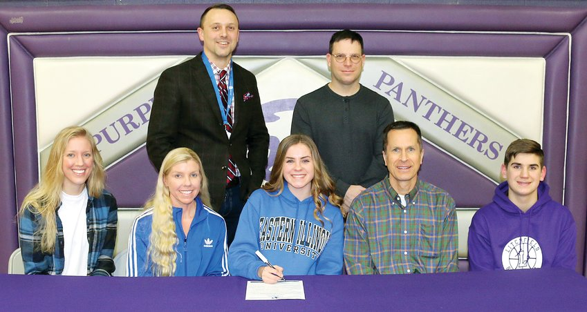 On Wednesday, Feb. 12, surrounded by friends and family, Litchfield High School senior Caroline Quarton signed her letter of intent to run cross country and track for Eastern Illinois University. Seated with Quarton (center) are sister Victoria, mother Lori, father Brian and brother Camden. Behind Quarton are coaches Shane Cress and Jeremy Palmer. Unable to make the photo were Quarton's sister Alexandria and coach Jon Yoch.