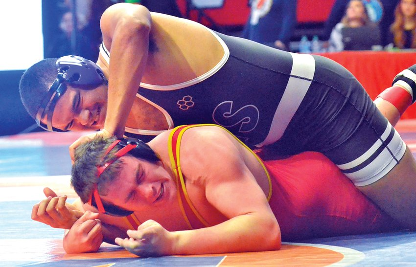 Litchfield senior Jefferson Thomas works to get position on Adam Maxwell of Warrensburg-Latham during their match on Friday, Feb. 21, at the IHSA State Wrestling Finals in Champaign. Thomas would lose 4-0 to Maxwell to end his season, but did pick up a win at state to put a bow on a stellar wrestling career.