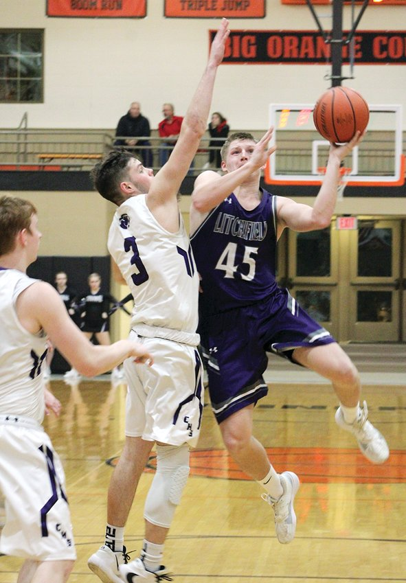 The Cougars of Breese Central were anything but a breeze for the Litchfield Purple Panthers on Tuesday, Feb. 25, at the Gillespie Regional. Central scored 37 points in the first half, en route to a 72-28 victory over Litchfield. Above, Litchfield senior Austin Niehaus tries to avoid Bradon Thomas' wingspan and add to the Panthers' side of the scoreboard. Niehaus had five points in his final game for Litchfield.