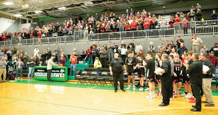Nokomis Head Coach Steve Kimbro receives a standing ovation after being honored by the officials at Meridian High School in Macon, following the Redskins' 58-43 regional championship loss to Central A&M on Feb. 28, that signified Kimbro's 1,146th, and last, game as head coach.