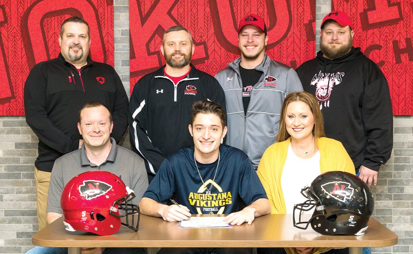 Nokomis' senior three-sport standout Alex Tosetti made his decision to play football for Augustana College official on Thursday, Feb. 20, signing his letter of intent to the Rock Island-based school. Sitting, in front, with Tosetti are his parents, Joe and Stacy Tosetti. In the back, from the left, are Nokomis football coaches Frank Steele, Head Coach Paul Watson, Nick Fox and Corey Black.