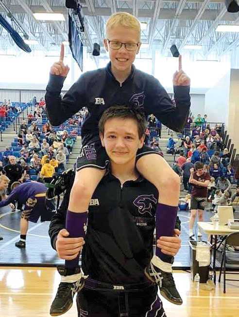 Litchfield Middle School sixth grader Vincent Moore gets a lift from teammate, eighth grader Hunter Hancock, after the pair qualified for the IESA State Tournament by both finishing third at the sectional in East Peoria. Unfortunately, the state tournament was cancelled due to concerns over the coronavirus and the health of the wrestlers and spectators.
