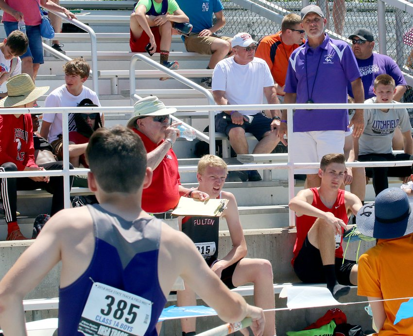 Litchfield track coach Dan Newkirk talks strategy with Bailey Powell (385) from the stands at the 2018 IHSA State Track Meet in Charleston. Newkirk, who is in his 30th year of coaching, said that he has never encountered a season like the 2020 campaign, which has seen more than a third of the team's meets cancelled due to the COVID-19 pandemic, with more cancellations expected.