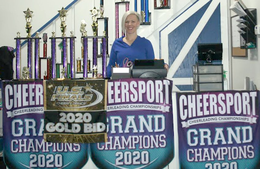 Above, Jenny Fergurson stands behind the counter at the Midwest Royals All Stars cheer gym in Litchfield. Fergurson took ownership of the gym in Jaunary.