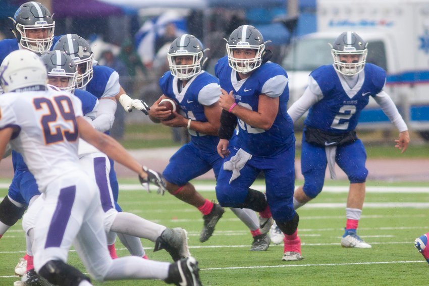Hillsboro grad Austin Grabow gets out in front to lead the Illinois College rushing attack during the Blueboys' homecoming football game against Knox College. Grab recently completed his career at Illinois College and will be attending law school in the future.