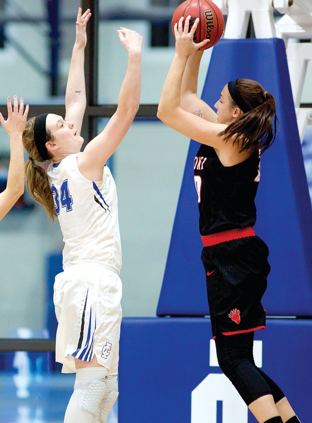 Illinois College senior Carly Cameron goes up for a block during a game against Lake Forrest. Cameron overcame an ACL tear during her time with the Lady Blues to average 10 points and 6.4 rebounds per game.