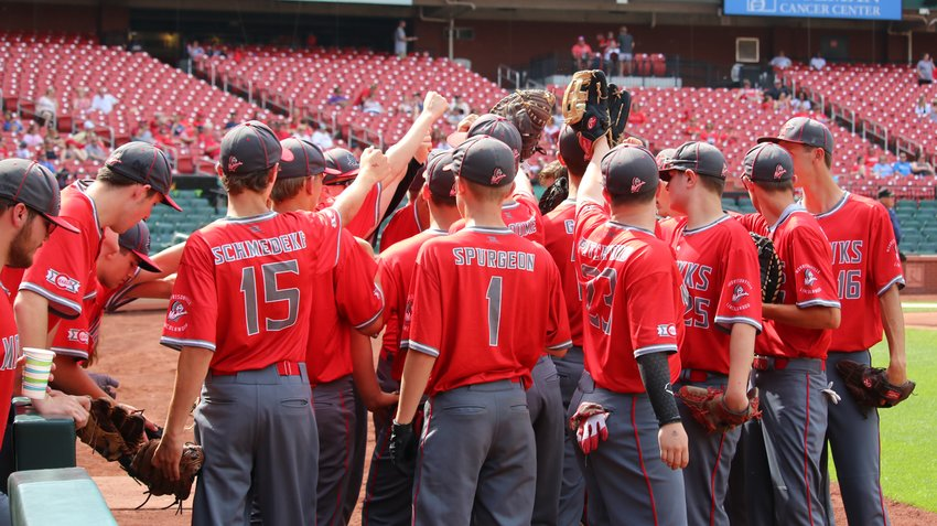 Members of the Morrisonville-Lincolnwood co-op baseball team huddle up during the Mohawks' game at Busch Stadium last June in St. Louis. This year's season was stopped before it could even get started due to the COVID-19 pandemic, which forced schools to close and the IHSA to cancel all spring sports state series this past Tuesday, April 21.