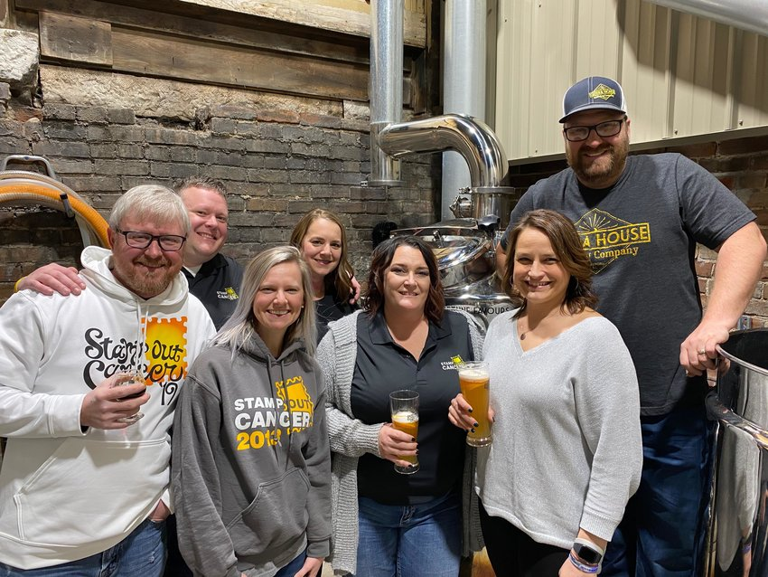 Members of the Stamp Out Cancer Committee joined Anthony Marcolini, owner of Opera House Brewing Company, to kick off the brewing of a special Stamp Out Cancer beer, Stamps Wygale, in mid-March. The beer will officially be released this Saturday. Pictured above, from the left are Stamp Out Cancer Committee members Chris Wygal, Zach Wygal, Dana Holshouser, Renee Laughlin, Michelle Hill and Theresa Priddle and Anthony Marcolini.