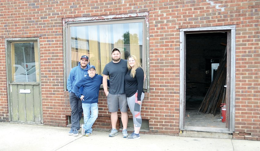 Tony and Kari Dragoo of Hillsboro, at right, are renovating the former Greasies building in downtown Hillsboro into a new restaurant. Helping them are Tony's coworkers at Atlas 46, Kyle Anderson, at left, and Derek Chesser.