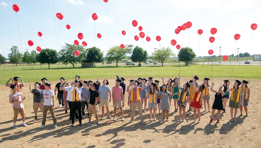 Nokomis High School graduates launched red balloons into the air on the high school baseball field following this year's commencement program on Saturday, June 6.