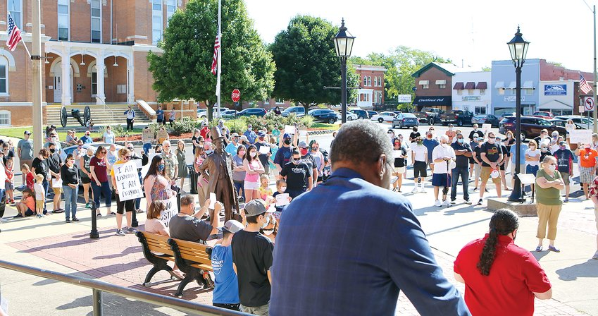 Nearly 200 gathered at Lincoln Plaza on Sunday morning, June 7, to rally in support of the Black Lives Matter movement.  After eight minutes and 46 seconds of silence, the Rev. James Hayes (foreground) led a prayer of unity before the event dispersed in silence.