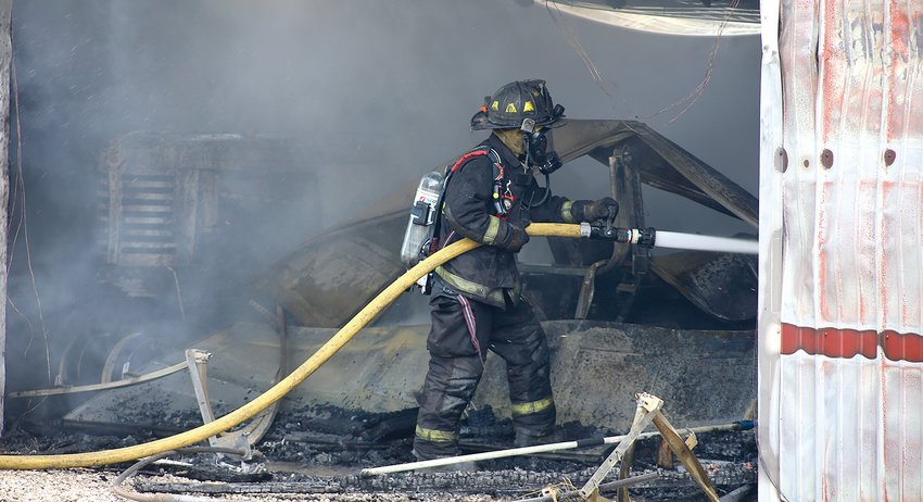 Firefighters battled a machine shed fire at the Lentz residence north of Coffeen Wednesday afternoon.