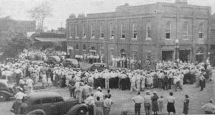 This photo is from the front page of the June 17, 1940, Hillsboro Journal showing the crowd gathered outside the Litchfield city jail where Jehovah's Witnesses were in protective custody.