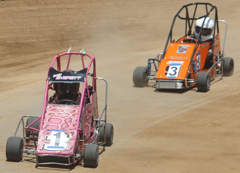 Bristol Everett tries to put some distance between her car and the number three during racing at Christian County Quarter Midget action on June 7.