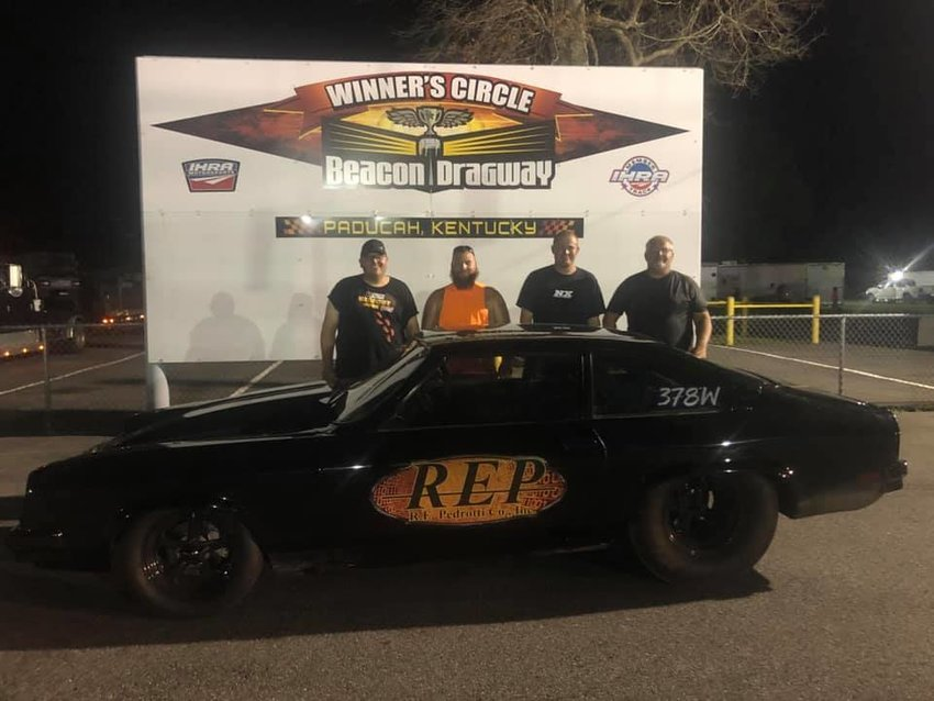 Corey Wood scored a big win and a $1,200 prize in the Super Pro class at Beacon Dragway in Paducah, KY, on Saturday, July 11. Pictured above, in victory lane at Beacon Dragway are Corey Wood, Robert Lee, Dustin Bryant and Phil Bryant.