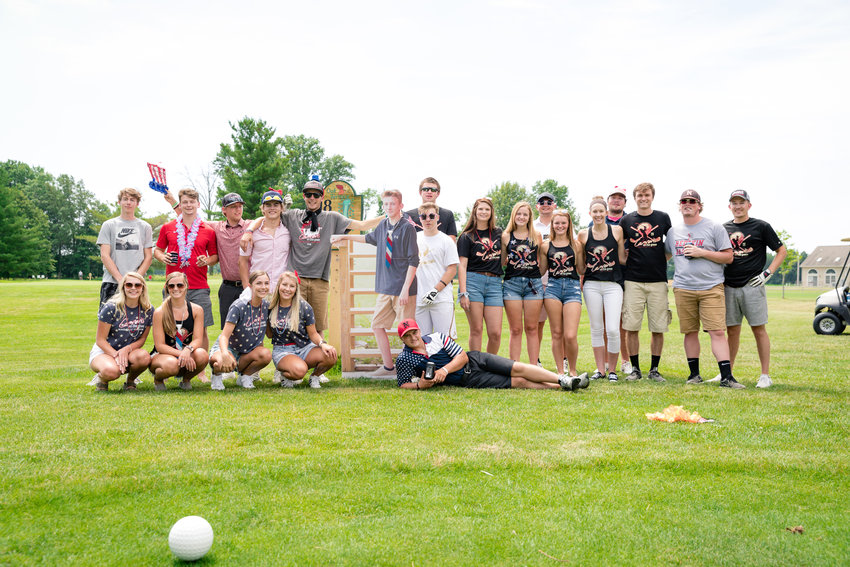 A life-sized cutout of the late Camren Neisler welcomed golfers to the eighth hole at Oak Terrace Resort, the site of the Camren's On the Green Memorial Golf Tournament on July 3. Dozens of Camren's friends, family and classmates came out for the event, which is held in honor of the 2018 Nokomis High School grad and benefits several community projects. Kneeling/Lying in front, from the left, are Alyssia Huber, Darian Ruppert, Delaney Clavin, Kayla Stauder and Ryan Archibald. In the back row are Marc Grigoroff,TJ Painter,  Mason Fesser, Connor Engelman, BJ Chausse, Camren Neisler, Logan Ernst, Josh Clymer, Kerstyn Hughes, Caela Wilkerson, Chris McQuire, Kenzie Earon, Taylor Lohman, Austin Akre, Hendrix Barnes, Andrew Herpstreith and Brendan Friesland. James Ryan/NokoPhoto