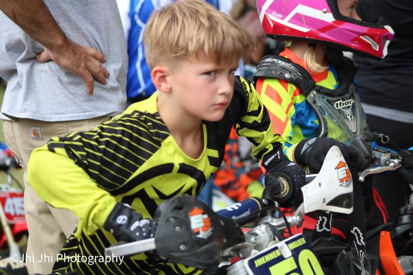 Off-road motorcycle racing is definitely a family affair for many local racers. Above is Jhenner Walker of Morrisonville, one of seven members of his family who race nearly every weekend all over the Midwest.