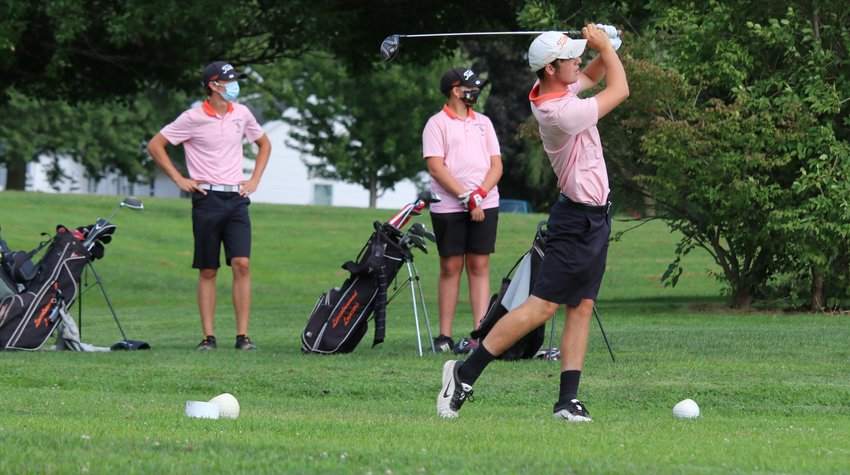 Monday's season opener for the Lincolnwood High School golf teams was hardly typical as the Lancers teed off at Shoal Creek Golf Course in Raymond. The match on Aug. 17 was the first varsity contest in Montgomery County since February after COVID-19 forced the cancellation of the spring sports seasons all across the state in March. Evidence of the pandemic still lingers as teams are restricted to playing teams in their own conference and geographic region and players must wear masks on the golf course when not playing. Above, masked and socially distant, Lincolnwood's Braxton Schmedeke and Nate Brockmeyer watch teammate Devin Brown's drive off the first tee.