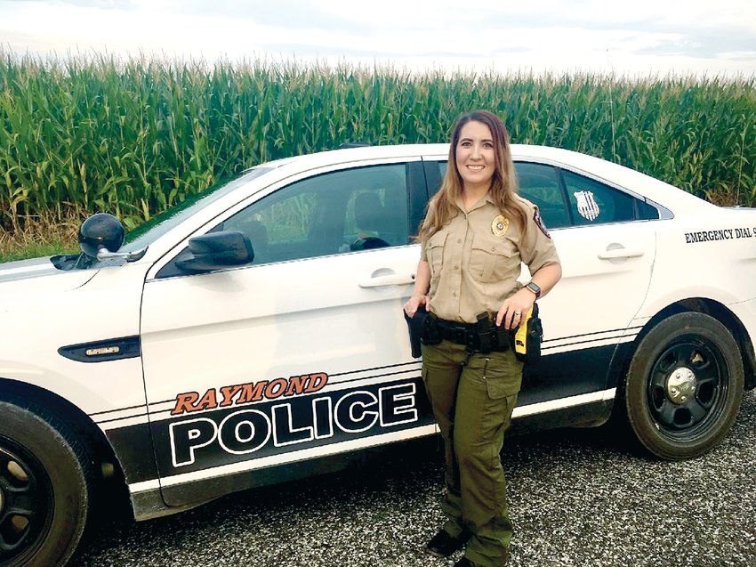 Kimberlee Wills of Carlinville began her new tenure on the Raymond Police Department in July, joining Police Chief Ben Jackson and Officer Matt Workmann.