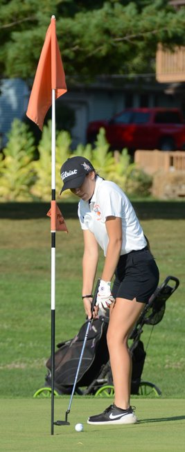 Lincolnwood's Micah Gehlbach watches her putt roll toward the hole on the par-4 first hole at Shoal Creek Golf Course on Sept. 3. Gehlbach shot a 53 to help the Lancers to a second place finish at the triangular.
