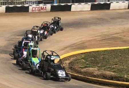 Litchfield racer Bodee Everett leads a pack of cars to the starting line during his Junior Animal heat race at the Christian County Quarter Midget Association track on Saturday, Aug. 29. Everett would go on to finish second in the feature race, which was the third regional in the Midwest Lightning .25 Midget Series.