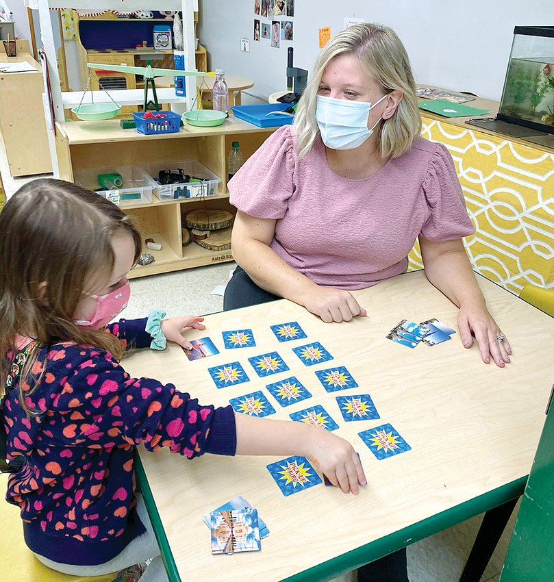 Ashley Jewell of the Hillsboro Community Child Development Center, at right, works with Ella Wildhaber on a matching game to stimulate brain development as part of the Little Leaps program.