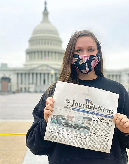 Hillsboro native Madison Baker is pictured with a copy of The Journal-News outside the Capitol Building in Washington DC, where she went to see the late Supreme Court justice Ruth Bader Ginsburg lie in state.