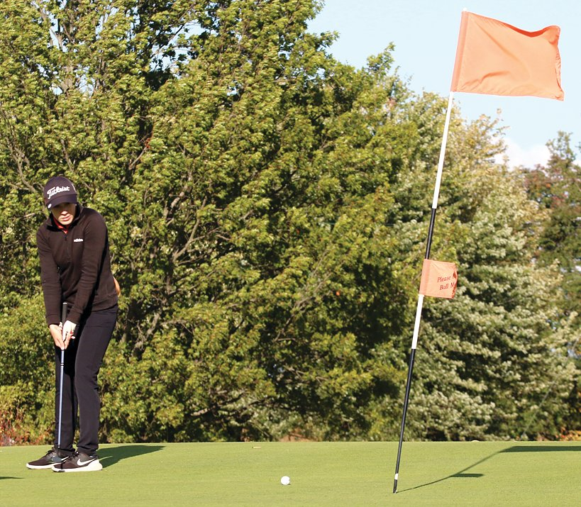 With a strong wind blowing across the ninth green, Micah Gehlbach watches her putt approach the hole during Lincolnwood's match on Oct. 1. Gehlbach, one of three seniors honored after the match, would birdie the hole and finished the match with a 52.