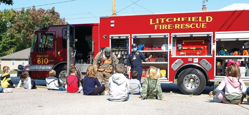 Pictured above, Litchfield firefighters Adam Pennock, at left, and Curt Glover, talk to pre-Kindergarten students at  Sihler School.