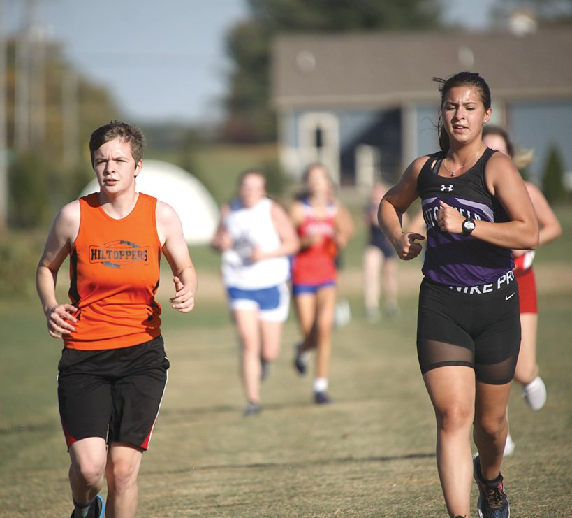 Hillsboro's Kelsey Holtgrave (left) and Litchfield's Karly Kruse lead a pack of runners during the meet at Greenville High School on Tuesday, Oct. 13. Both teams would have good results in Comet Country, with Kruse one of three Panthers to finish in the top ten, while Holtgrave and the Hiltoppers won their first meet in nearly two decades.