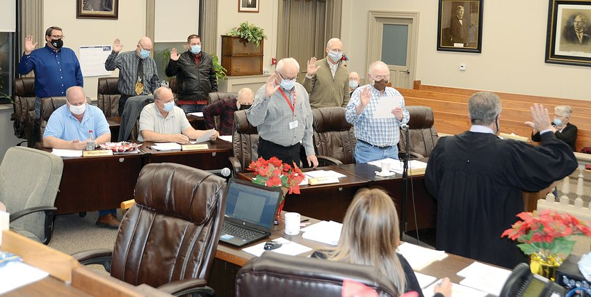 Judge Jim Roberts of Hillsboro, at right, administered the oath of office to 11 members of the Montgomery County Board elected in the Nov. 3 election, during the board's re-organization meeting on Monday evening, Dec. 7.