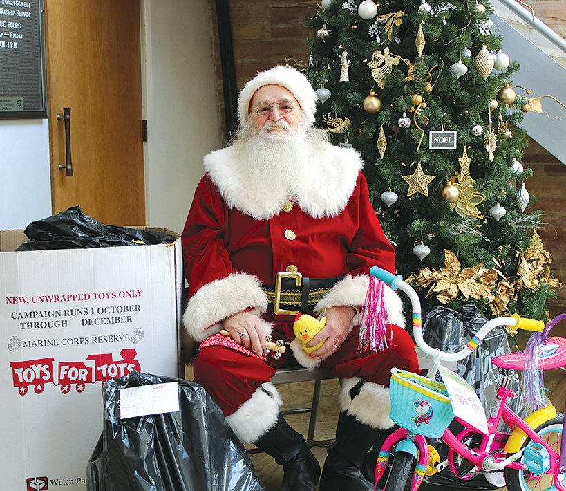 Santa, assisted by Fred Roach of Hillsboro, was on hand to wave at each of the children who stopped by the Toys For Tots drive on Monday, Dec. 14.