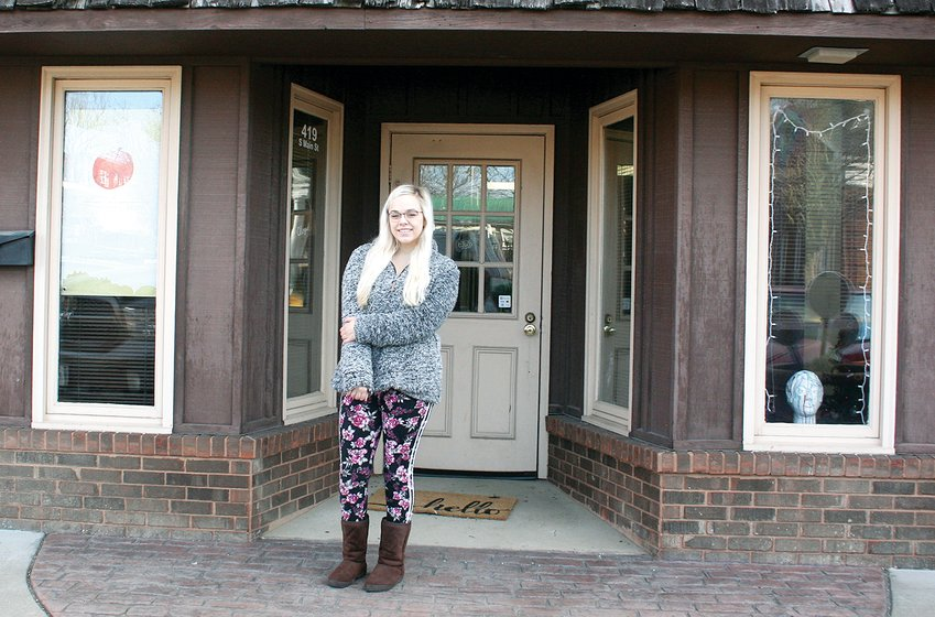 Taylor Meyers (above) stands outside Taylor Kay Art Gallery, located at 419 South Main Street in Hillsboro. The gallery will officially open on Saturday, Jan. 30.