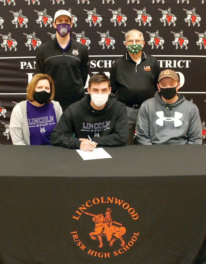 Lincolnwood High School senior Devin Brown (center)signed his letter of intent to play golf at Lincoln College on Thursday, Jan. 21. Seated  with Brown are his parents, Kimberly and Zach Denney. In the back, from the left, are Lincoln College Head Coach Wade Mathis and Lincolnwood Head Coach Verne Pinkston.