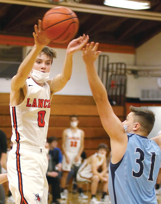 Lincolnwood's Braden Whalen dishes to an open teammate during the Lancers' season opener against Sangamon Valley on Saturday, Feb. 6. Whalen would have a team-best 19 points in Lincolnwood's 58-42 win over the Storm.