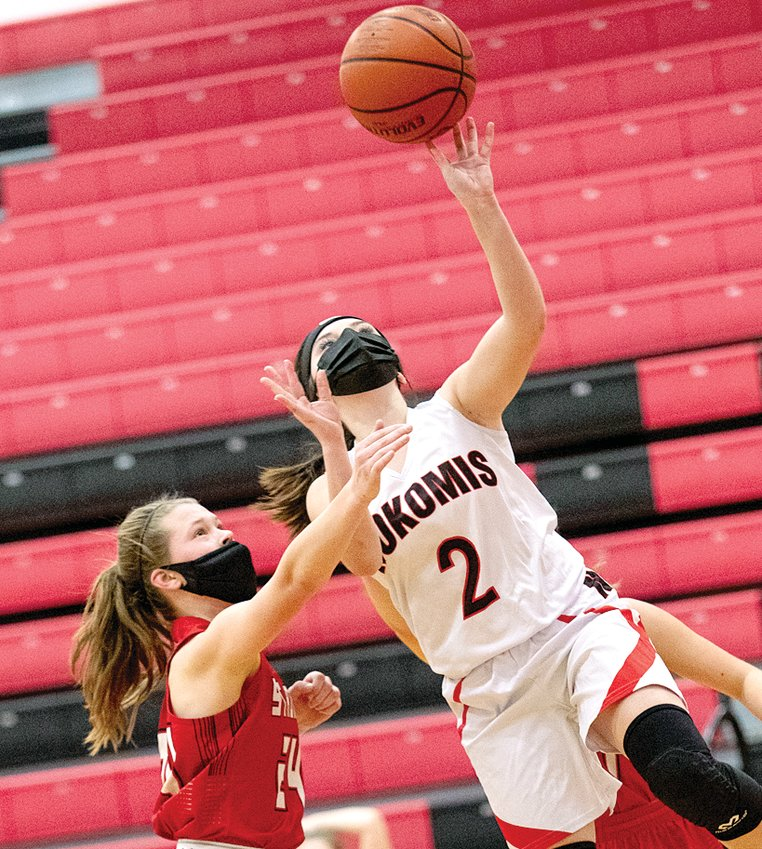 Nokomis' Emma Sneddon goes up for two of her six points in the Lady Redskins' 52-38 victory over Staunton on Saturday, Feb. 6.