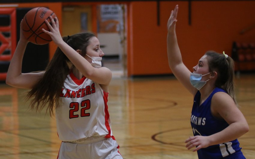 Lincolnwood senior Cassie Krager looks for an open teammate inside during the Lady Lancers' season opener on Saturday, Feb. 6, against North Greene. Led by Cami Hurt's 18 points, North Greene would spoil the Lancers' home debut with a 50-17 final score.