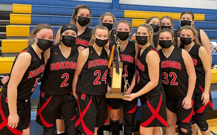 In their first game in the MSM Conference, the Nokomis girls basketball team knocked off MSM power Tri-City 50-46 on Monday, Feb. 8, to take possession of the conference's traveling trophy. In front, from the left, are Natalie Engelman, Emma Sneddon, Jayme Johnson, Kristen Stauder, Mia Fesser, Carley King and Addison Dangbar. In the back row are Audrey Sabol, Cydney Bertolino, Hailey Engelman, Emily Cress and Kalyn Davis.