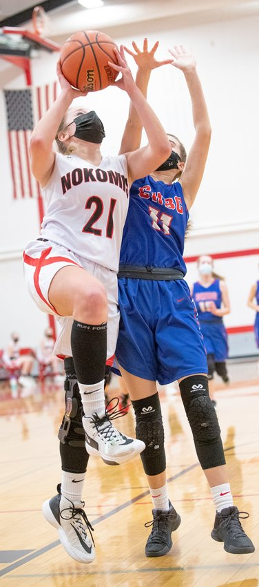 Nokomis senior Kristen Stauder goes up for two of her ten points in the Lady Redskins' 60-50 win over Cowden-Herrick-Beecher City on Saturday, Feb. 13. The win moved the Lady Redskins to 4-0 on the season.