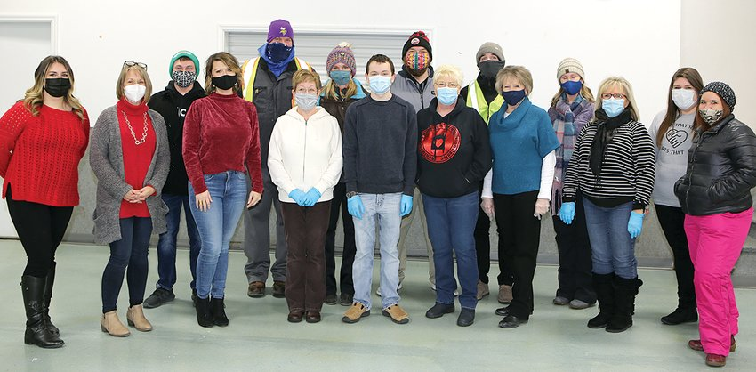 Usually, the group photo for the Hillsboro Area Health Foundation annual Valentine Gala is of 35-or-so smiling faces in bow ties.  This year, it was a  few heartly volunteers in masked faces and bundled up for the cold.  From the left are Kaitlyn Fath, Barb Boston, Lucas Altenberger, Claire Eskew, Jeremy Connor, Heather Plunkett, Jessica Chappelear, August Plunkett, Dustin Jones, Tammy Richmond, Brian Limbaugh, Mary Brown, Paula Collins, Billie Owen, Kristen Taylor and Melanie Sherer.  Not present for photo: Mike Plunkett, Sara Eller.