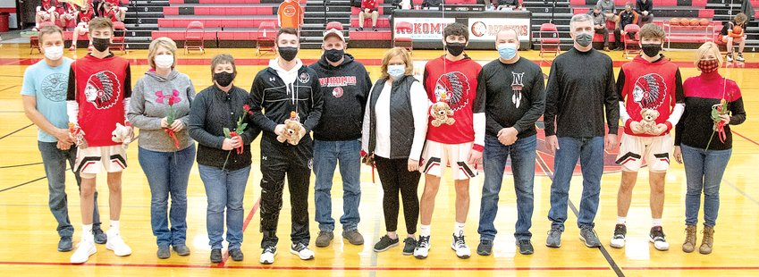The four senior members of the Nokomis High School boys basketball team were honored on senior night prior to the Redskins' game against Hillsboro on Saturday, Feb. 20. From the left are Benny Clavin, son of Tricia and Jim Havera and the late Eric Clavin; Evan Herpstreith, son of Cheri and Scott Herpstreith; Seth Johnson, son of Janette and Larry Johnson and Kendall Knodle, son of Brian Knodle and Heather Hampton+Knodle.