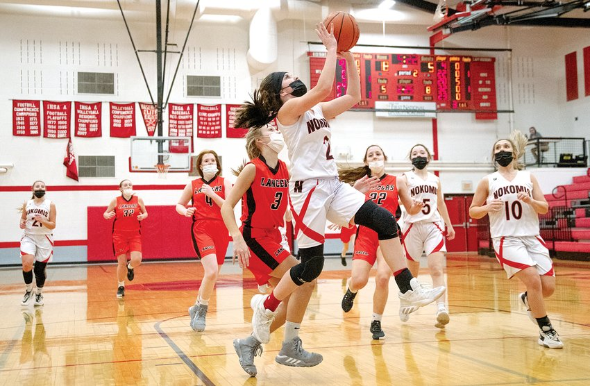 Nokomis' Emma Sneddon goes up for two of her five points during the Lady Redskins' 51-26 victory over Lincolnwood on Saturday, March 6. The win gave Nokomis a 6-0 record and a conference championship in the MSM Conference.