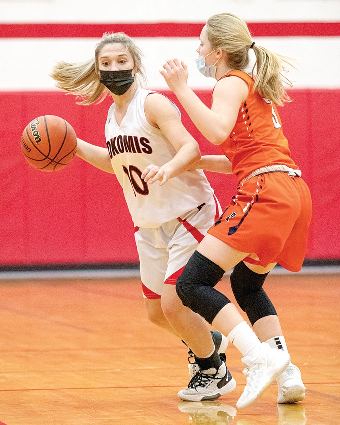Nokomis senior Mia Fesser brings the ball down the floor against Pana's Anna Beyers during the Redskins' senior night game against the Panthers on Wednesday, March 10.