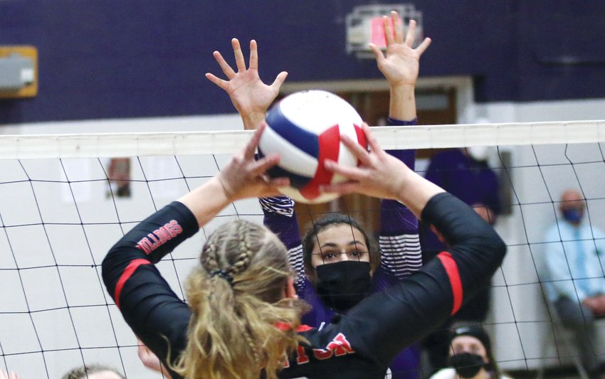 Litchfield senior Becky Painter extends for the block against Staunton's sophomore standout Haris Legendre during the Purple Panthers' two set loss against the Lady Bulldogs on March 16.
