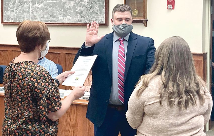 Devon Schoen was sworn in by City Clerk Carol Burke, along with Schoen's fiance Kristin Bertolis, as the newest member of the Litchfield Police Department on Thursday, April 1, prior to the meeting of the Litchfield City Council.