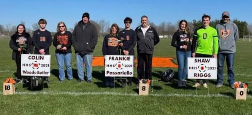 It was senior night for the Hillsboro High School soccer team on Thursday, April 1, as the Toppers celebrated with a 1-0 win over Staunton. Seniors, with their parents, from the left are Nicole Woods, Colin Woods-Butler, Laura Butler, Fred Butler, Kellea Passariello, Frankie Passariello, Vito Passariello, Melody Riggs, Shaw Riggs and David Riggs.